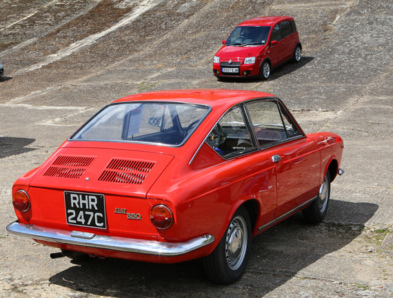 This 1965 Fiat 850 Coupe benefited from spending the first 50 years of her life enjoying Italian Sunshine. Behind on the banking is a rather more recent baby performance Fiat, namely a 100 HP Panda.To the left of the shot is an even quicker Fiat, or should I say 500 Abarth.