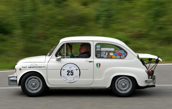Looking exactly as you would expect an Abarth to look like, engine cover propped up on struts Fausto Galli's 1965 Fiat Abarth 850TC.