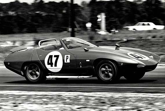 Triumph driver Jim Dittemore at speed on the Sebring circuit. Note the K-car's rear spoiler has been raised for increased down-force and high speed stability in the turns.