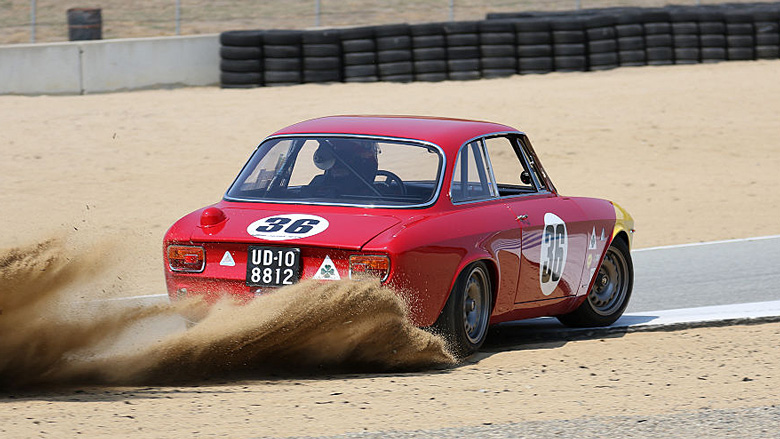 The surroundings of the circuit are very sandy as the driver of this 965 Alfa Romeo GTA Corsa found out.