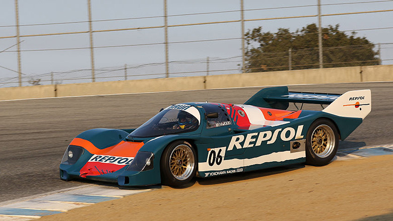 Full attack for this 1988 Porsche 962 C at the Corkscrew.  A week later, a string of old tires were put at the same place so that cutting the corner was not possible anymore.