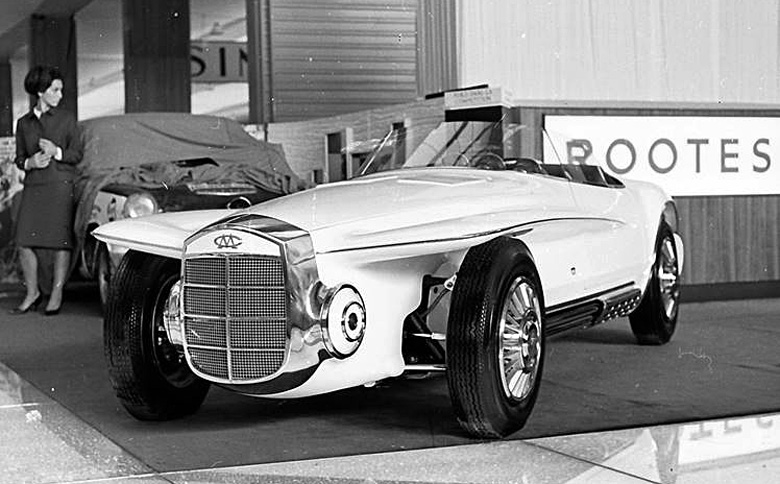 The Mercer Cobra photographed sixty years ago on the stand at the Paris Auto Show. Note the MC stylized badge on the front.