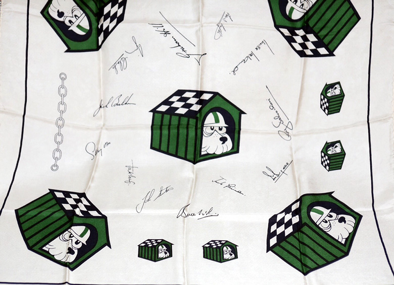 Dog House Owner's Club silk scarf.  The Club was made up of ladies who had some connection to Formula One racing in the 50s, 60s and 70s.   In many cases their husbands were owners or drivers.  Many of the signatures of the drivers were replicated on this scarf.