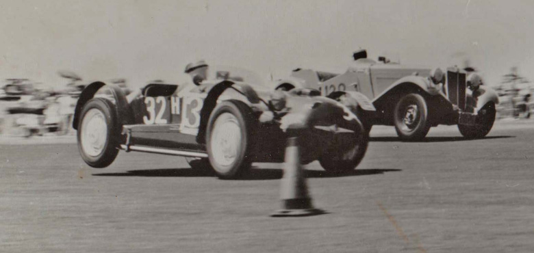 Cornering on three wheels in the 1950s, probably John Porter at the wheel.